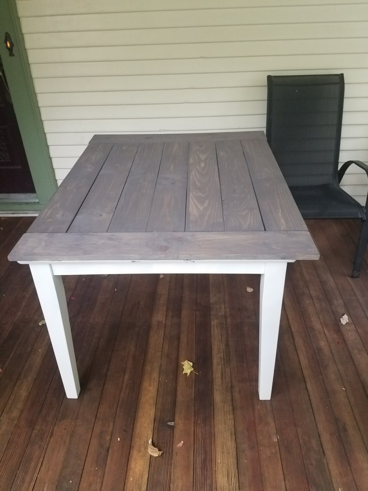 Mid-hack, stain is being added to this DIY Farmhouse Table.