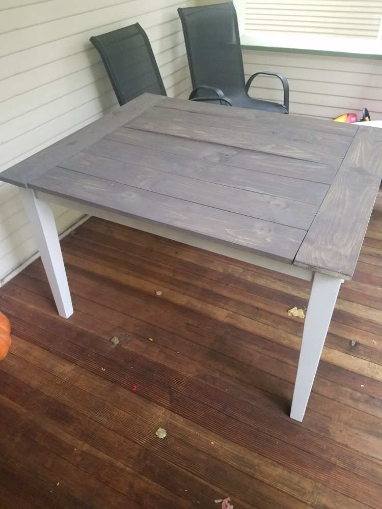 Mid-Table Hack, Stain is being applied to the top of the table.