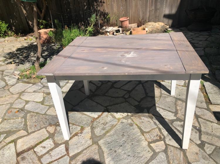 Adding sealant to the DIY Farmhouse Table.